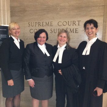 Picture of West Coast LEAF members in front of the Supreme Court of Canada