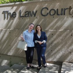 Summer 2018 Legal Interns Celeste and Katie standing on the steps of the Vancouver Law Courts