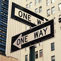 """Street Signs that both read """"One Way"""" pointing in different directions"""