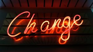 "Photo of orange glowing neon sign that says ""Change"""