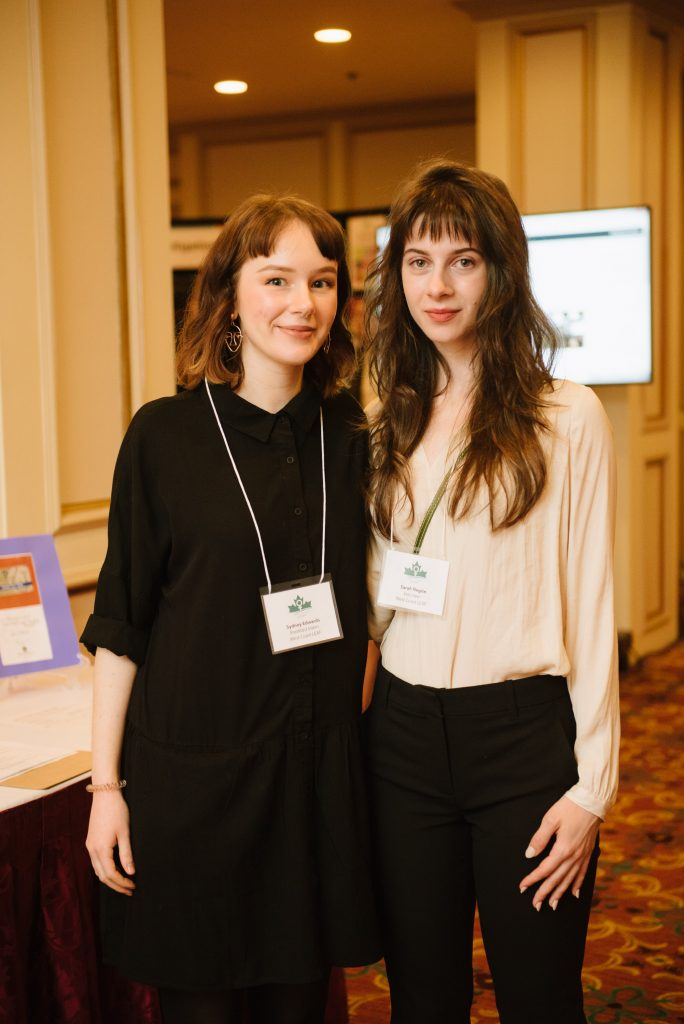two individuals attending an event stand together