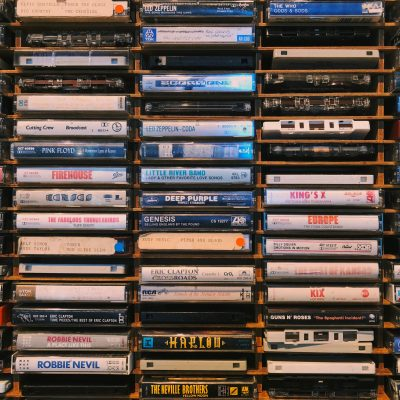 A photo of shelf holding an assortment of music tapes