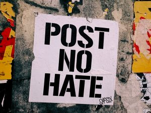 "Photo of poster on a wall that reads, ""POST NO HATE"""