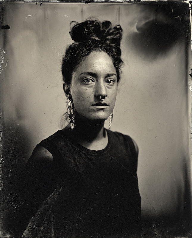 A black and white portrait of photographer Kali Spitzer