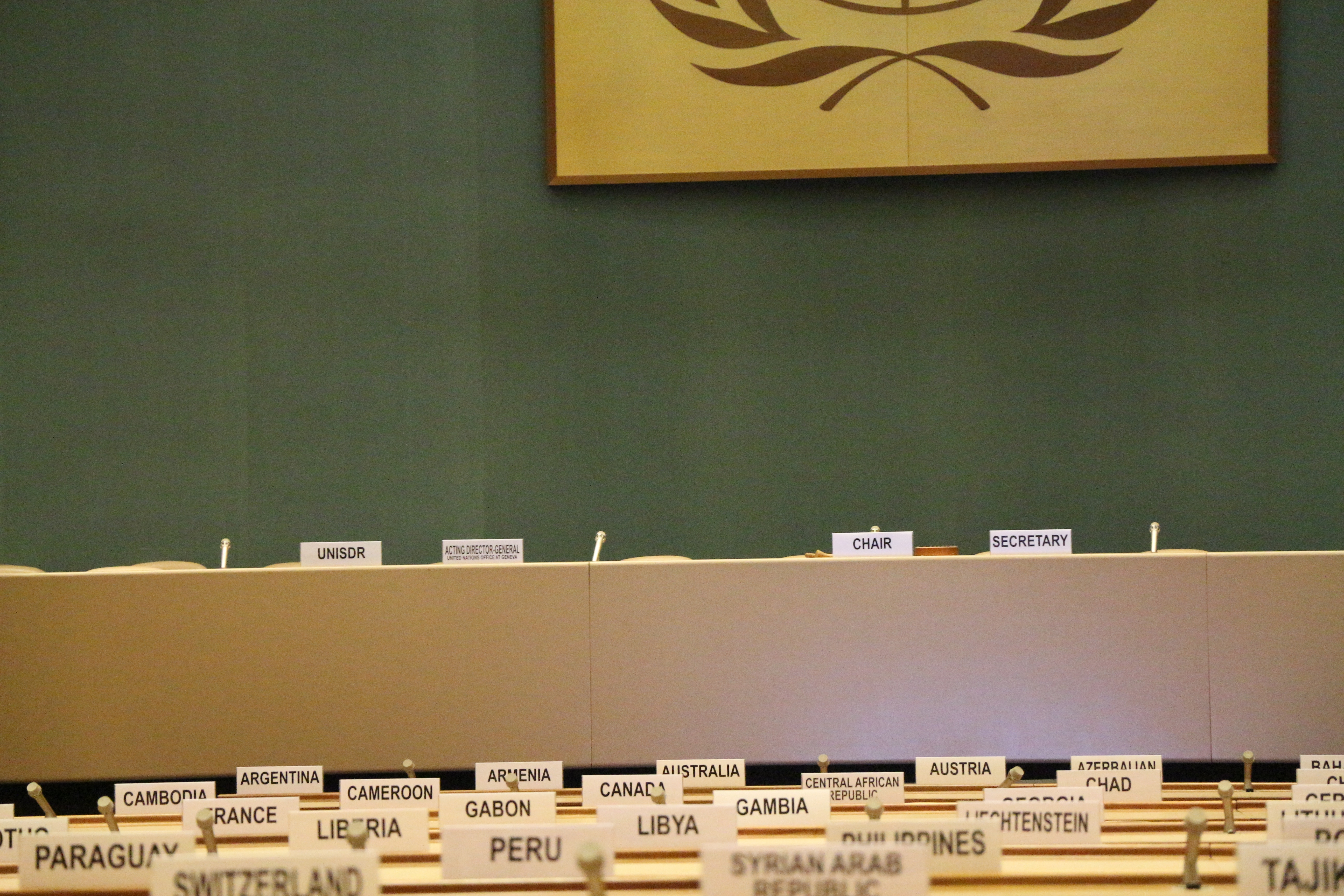 place markers at tables that bear the names of countries