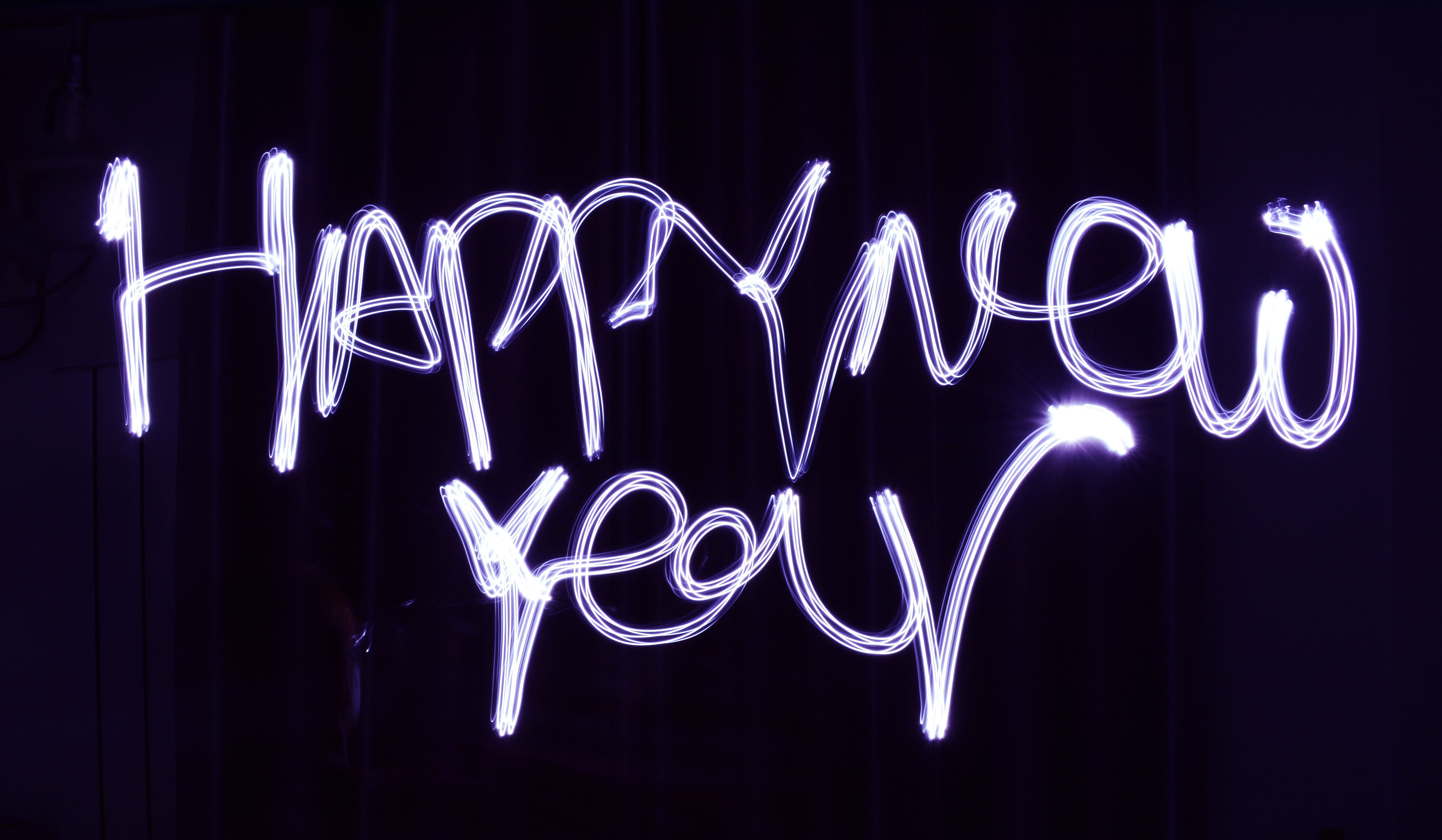 """Photo that in handwriting says """"Happy New Year"""""""