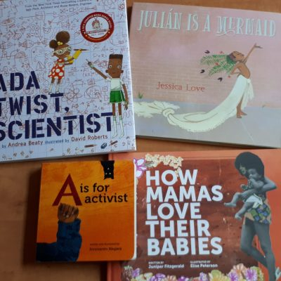 """the covers of four books. they are entitled (from upper left to lower right) """"ada twist: scientist,"""" """"julian is a mermaid,"""" """"A is for activist,"""" and """"how mamas love their babies"""""""
