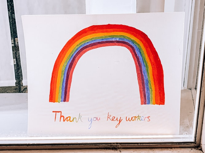 """A drawing of a rainbow that reads """"Thank you key workers"""""""