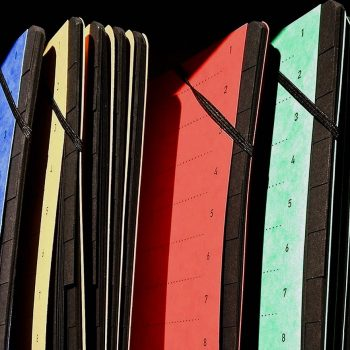 Colourful file folders in a row with shadowy lighting